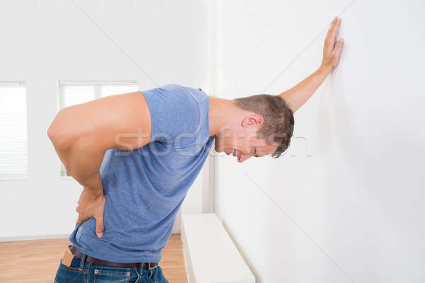 Man Having Backache Stock photo © AndreyPopov