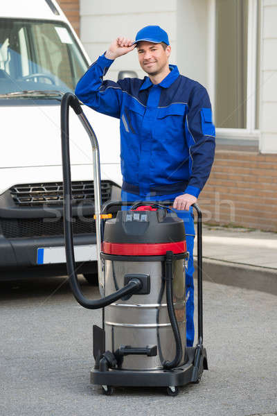Janitor Wearing Cap While Standing On Street Stock photo © AndreyPopov
