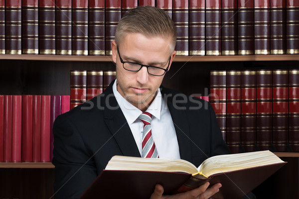 Lawyer Reading Book At Courtroom Stock photo © AndreyPopov