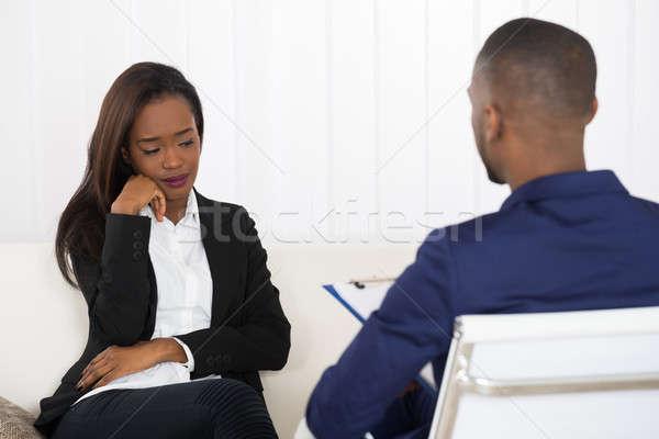 Mulher jovem psiquiatra deprimido africano americano mulher nomeação Foto stock © AndreyPopov