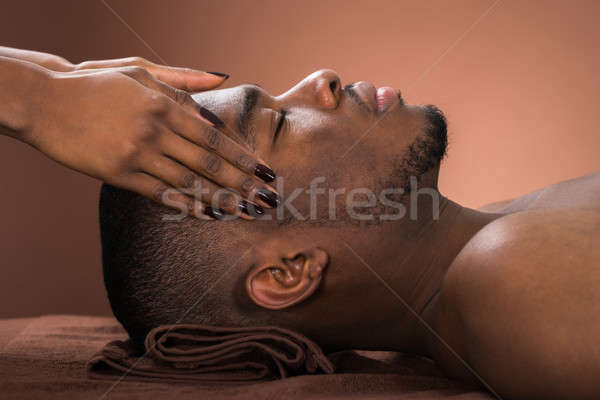 Man Receiving Forehead Massage Stock photo © AndreyPopov