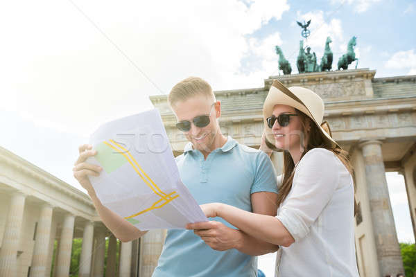 Stock photo: Young Couple Looking At Map