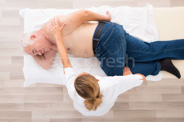 Masseur massage senior man Stockfoto © AndreyPopov