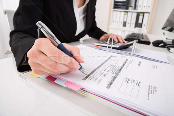 Businesswoman Hand Calculating Business Report Stock photo © AndreyPopov