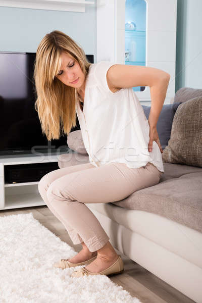 Woman Suffering From Backache At Home Stock photo © AndreyPopov