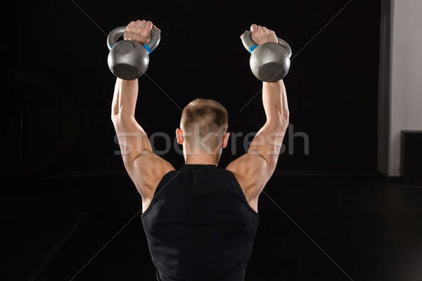 Man Doing Exercise With Kettle Bell Stock photo © AndreyPopov