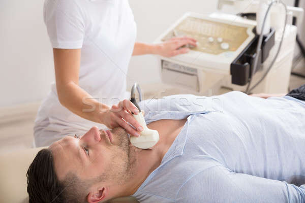 Young Man Getting Ultrasound Of A Thyroid Stock photo © AndreyPopov