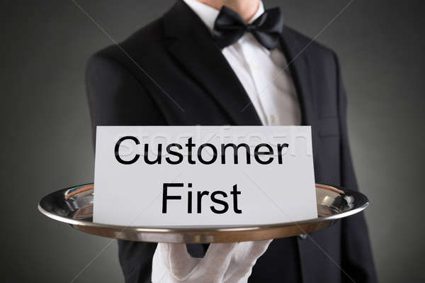 Waiter Holding Customer First Card On Tray Stock photo © AndreyPopov