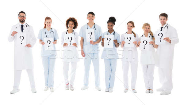 Stock photo: Group Of Multiracial Doctors Holding Question Mark Sign