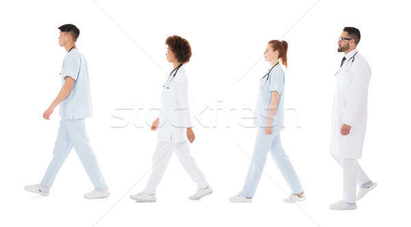 Multiracial Medical Team Walking In Row Stock photo © AndreyPopov