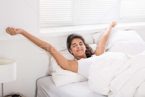 Smiling Woman On Bed Wake Up Stock photo © AndreyPopov