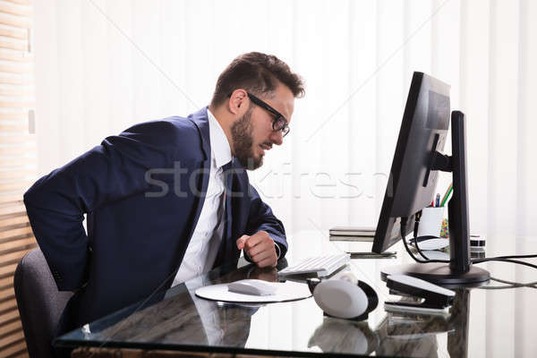 Businessman Suffering From Backache Stock photo © AndreyPopov