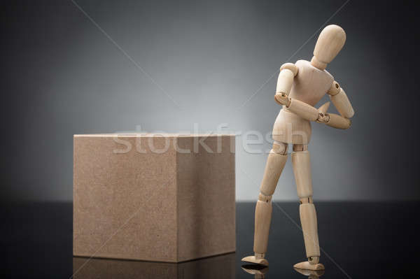 Wooden Dummy Standing Cardboard Box Suffering From Back Pain Stock photo © AndreyPopov