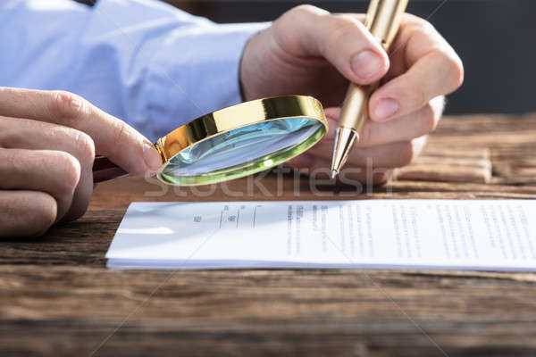 Businessperson Looking At Document Through Magnifying Glass Stock photo © AndreyPopov