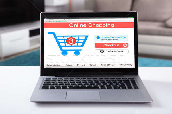 Compras on-line site laptop branco secretária Foto stock © AndreyPopov