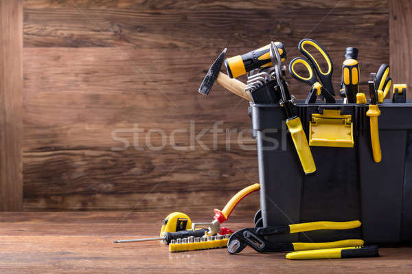 Plastic Black Container With Many Tools Stock photo © AndreyPopov