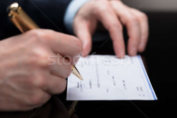 Ondertekening cheque pen business Stockfoto © AndreyPopov