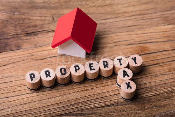 Casa modello blocchi proprietà fiscali testo Foto d'archivio © AndreyPopov