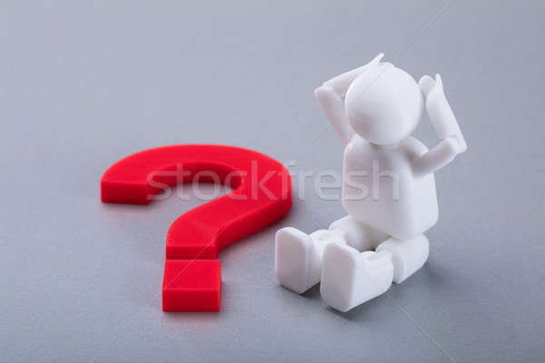Human Figure Sitting Beside Red Question Mark Sign Stock photo © AndreyPopov