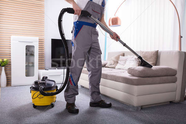 Person Cleaning Sofa With Vacuum Cleaner Stock photo © AndreyPopov