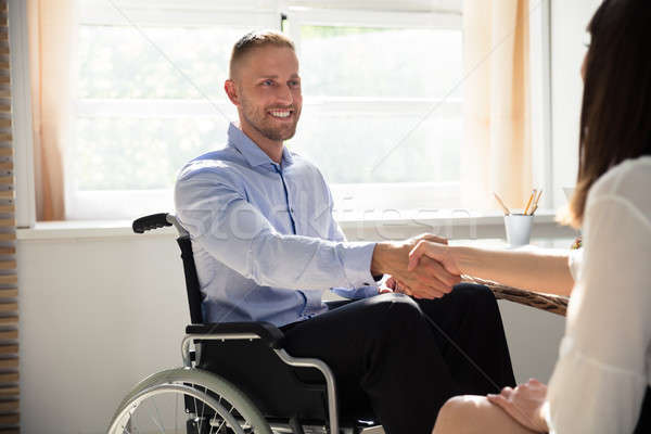 Disabled Businessman Shaking Hand With His Partner Stock photo © AndreyPopov