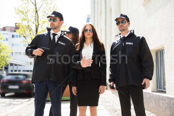 Portrait Of Young Businesswoman With Bodyguards Stock photo © AndreyPopov