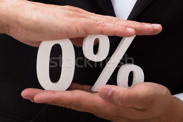 Businessperson protecting zero percentage symbol Stock photo © AndreyPopov