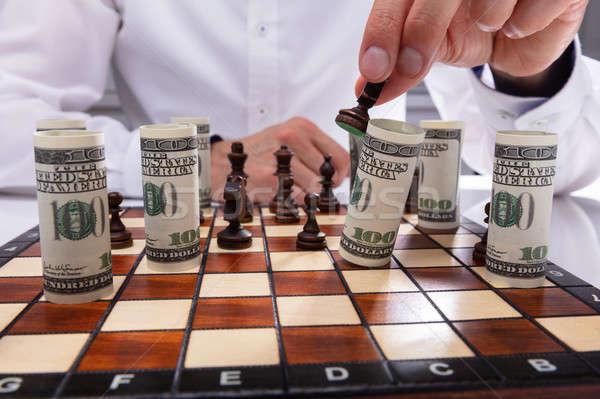 Személy zuhan bankjegy sakkfigura közelkép tekert Stock fotó © AndreyPopov
