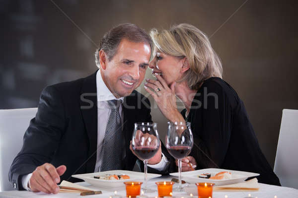 Cheerful Woman Whispering In Man's Ear Stock photo © AndreyPopov