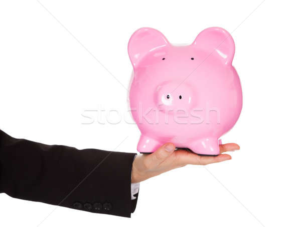Businessman holding out a piggybank Stock photo © AndreyPopov