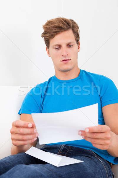 Shocked Man Holding Paper Stock photo © AndreyPopov