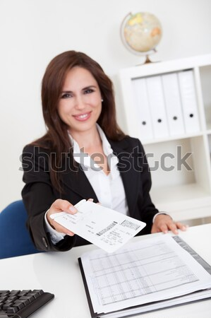 Smiling accountant sitting at her desk working Stock photo © AndreyPopov