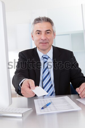 Senior Business Man Offering Visiting Card Stock photo © AndreyPopov