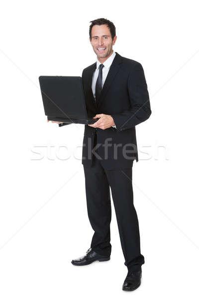 Boldog középkorú üzletember laptop izolált fehér Stock fotó © AndreyPopov