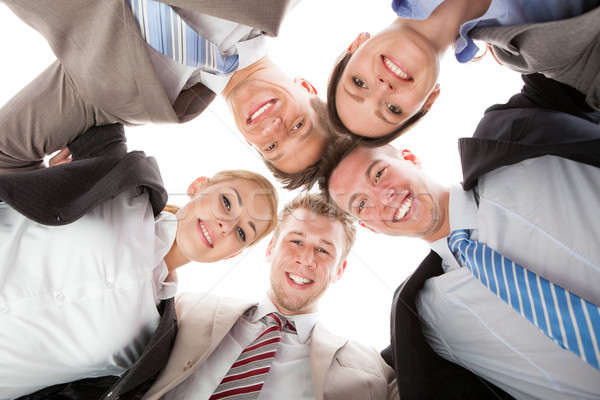 Confident Business Team Making Huddle Stock photo © AndreyPopov
