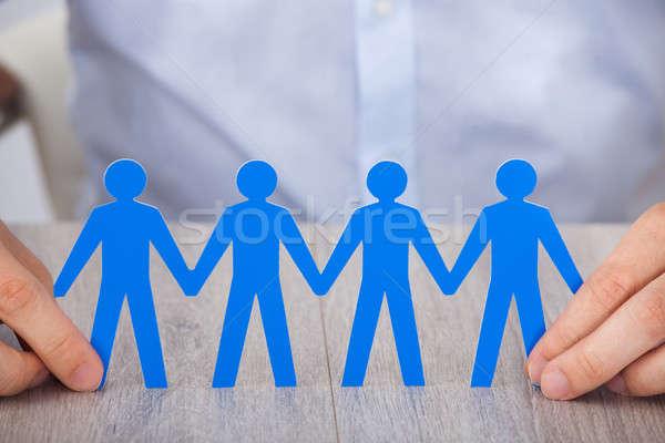 Kéz tart papír emberek lánc közelkép Stock fotó © AndreyPopov