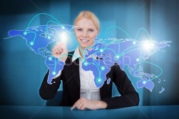 Zakenvrouw aanraken wereldkaart portret jonge wereldwijde business Stockfoto © AndreyPopov