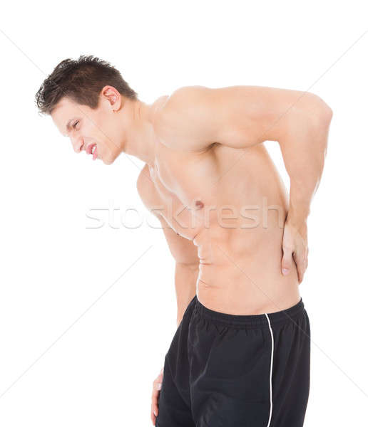 Young Man Suffering From Back Pain Stock photo © AndreyPopov