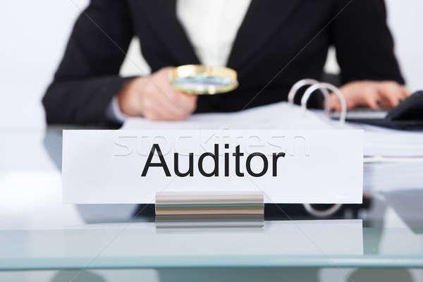 Auditor Scrutinizing Financial Documents Stock photo © AndreyPopov