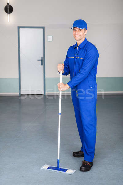 Worker Cleaning Floor Stock photo © AndreyPopov