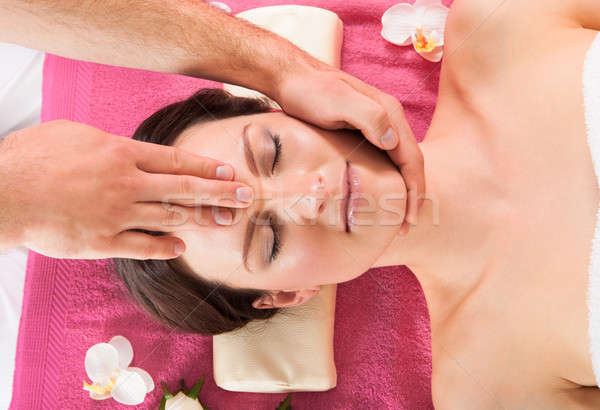 Woman Receiving Head Massage In Beauty Spa Stock photo © AndreyPopov