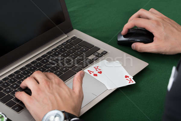 Businessman With Cards Using Laptop Stock photo © AndreyPopov