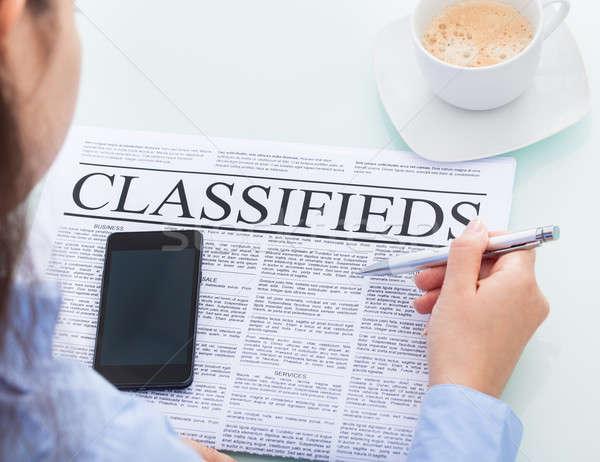 Businesswoman Reading Classifieds Stock photo © AndreyPopov