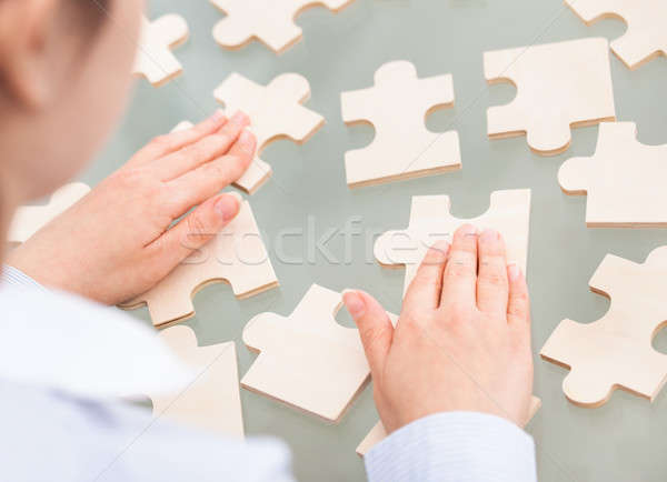 Businesswoman With Scattered Puzzle Stock photo © AndreyPopov