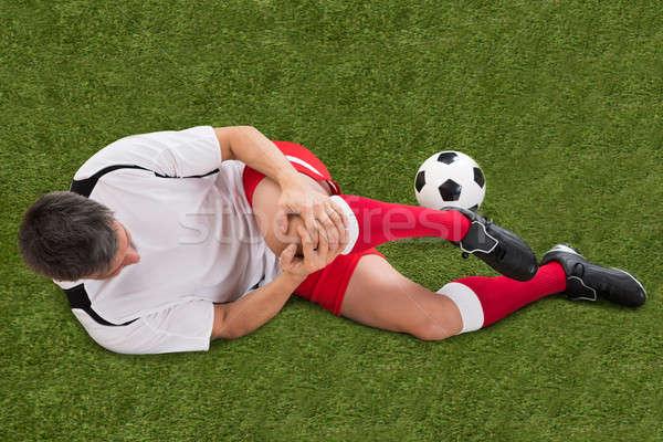 Calciatore lesioni ginocchio maschio sofferenza mano Foto d'archivio © AndreyPopov