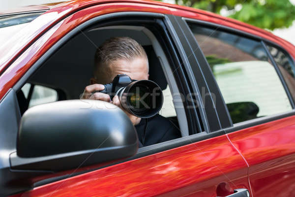Man Photographing With Slr Camera From Car Stock photo © AndreyPopov