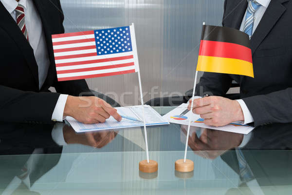 Close-up Of American And German Businessman Stock photo © AndreyPopov