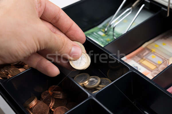 Person Hands Putting Coins In Cash Register Stock photo © AndreyPopov