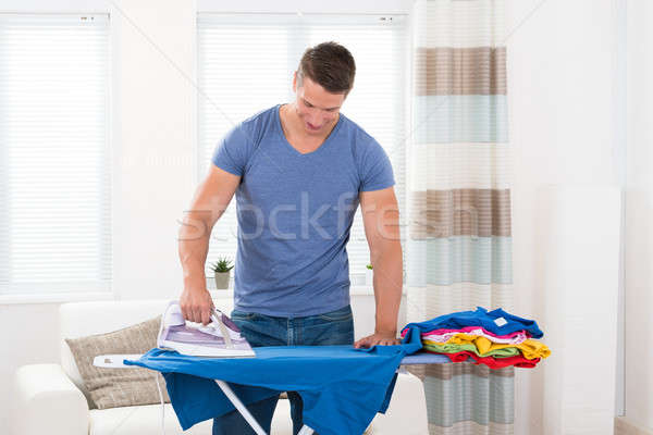 Young Man Ironing Clothes Stock photo © AndreyPopov
