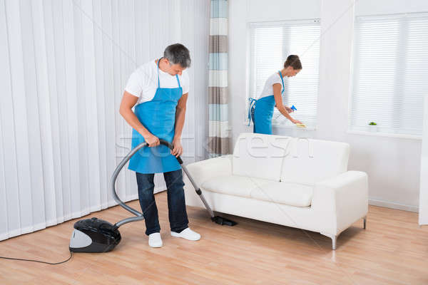 Dos limpieza oficina uniforme salón casa Foto stock © AndreyPopov
